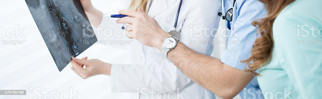 Young doctors analyzing brain MRI stock photo