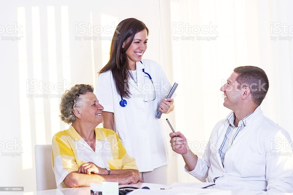 Young doctors with patient. royalty-free stock photo