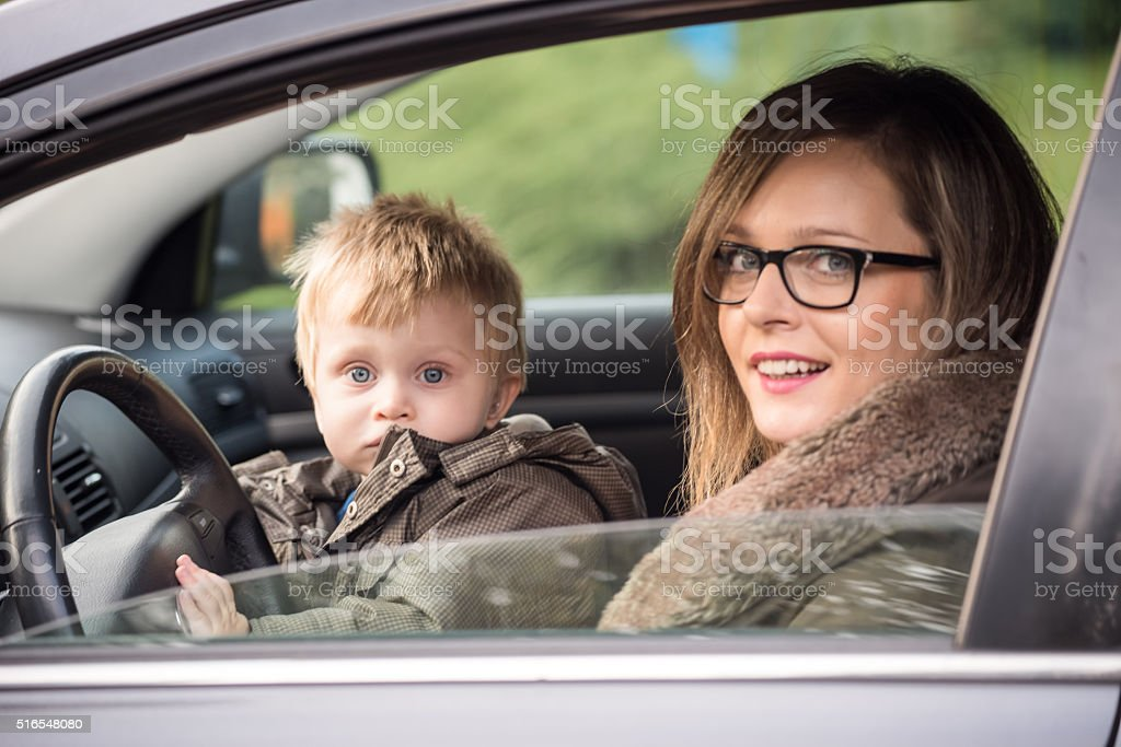 Young driver and his mother stock photo