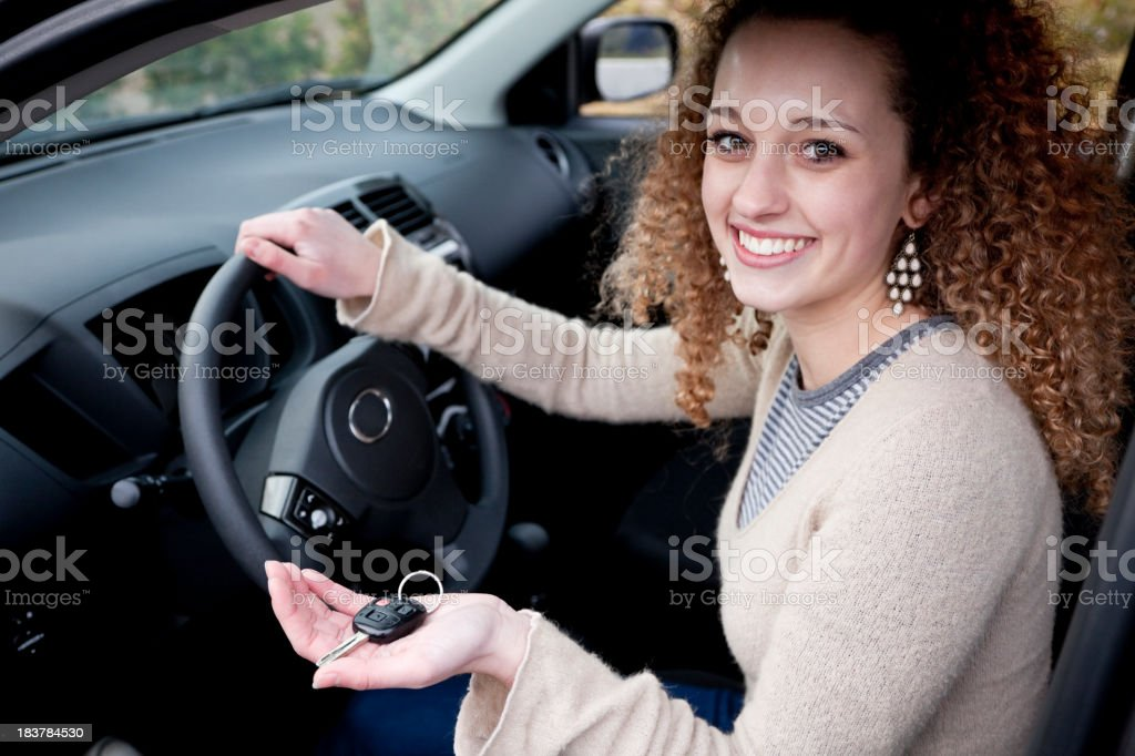 Young driver holding showing car key stock photo