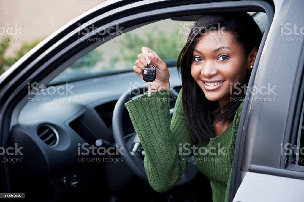 Young driver holding up car key stock photo