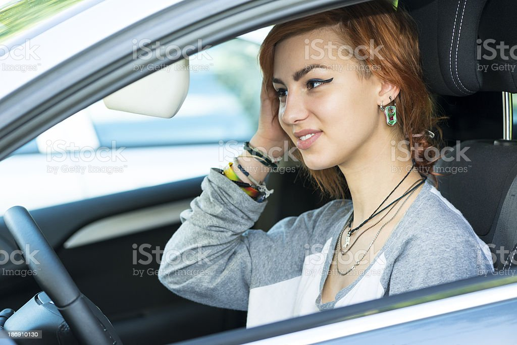 Young driver in a car checking her make up royalty-free stock photo