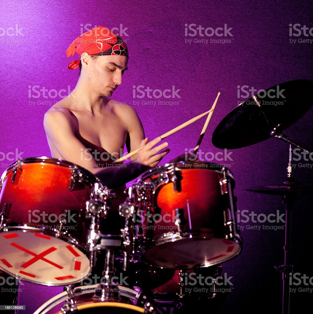 Young drummer playing drums royalty-free stock photo
