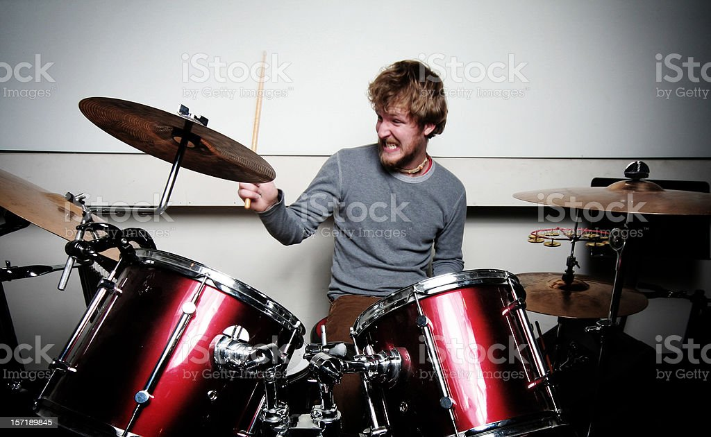 Young Drummer Playing Drums With Passion stock photo