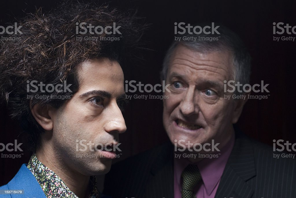 Young dude being yelled at by older man royalty-free stock photo