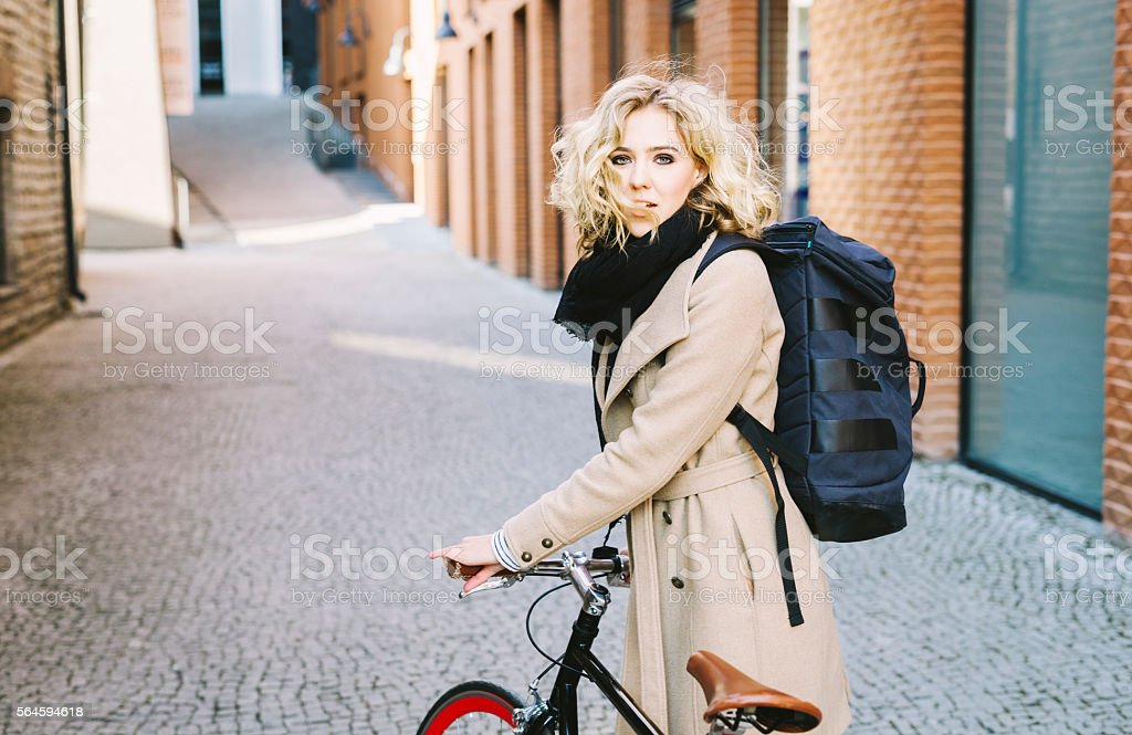 A portrait of a stylish and seductive looking girl riding her bicycle...
