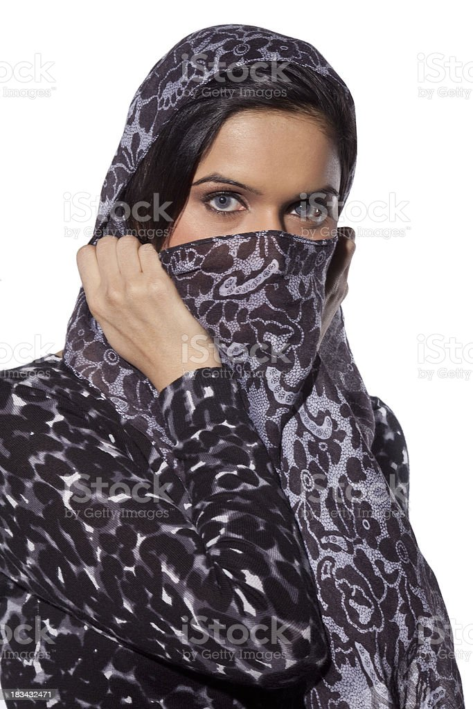Young East Indian woman covering her face with a scarf royalty-free stock photo