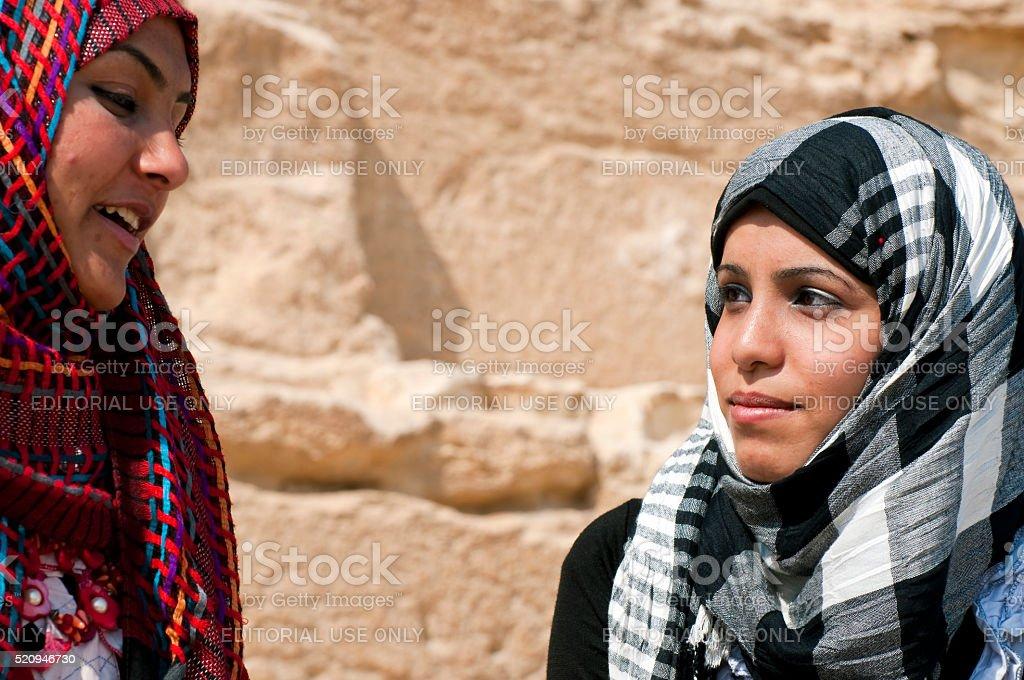 Young Egyptian Muslim women at the Giza Pyramids stock photo