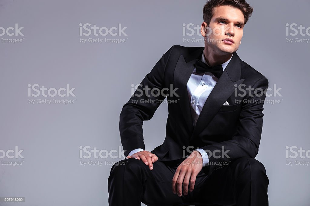 Young elegant business man sitting stock photo
