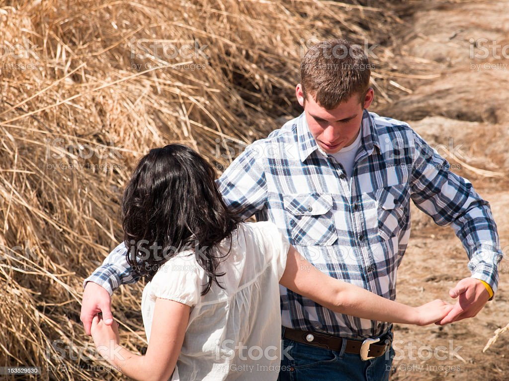 Young elegant couple dancing in a wheat field stock photo