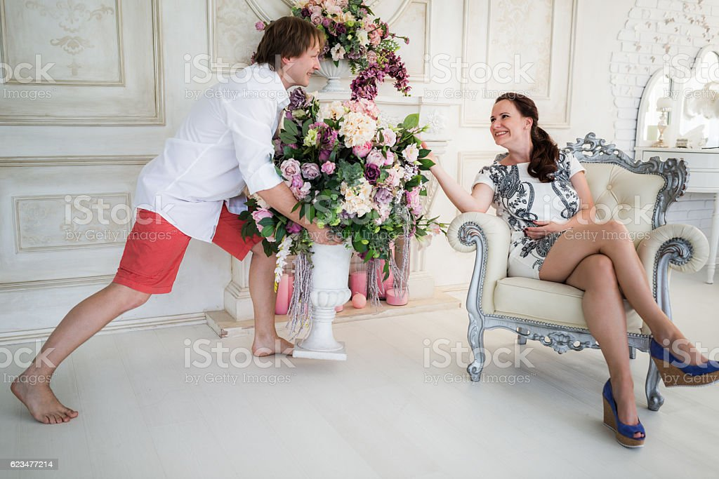 Young elegant couples in flowers stock photo
