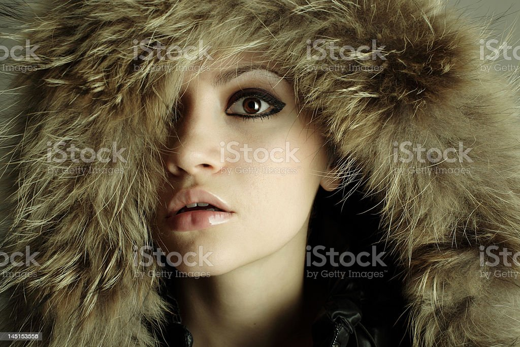 young elegant girl with fur coat royalty-free stock photo