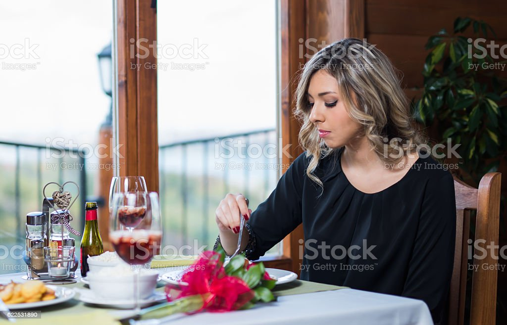 Young elegant woman enjoying lunch in the restaurant stock photo