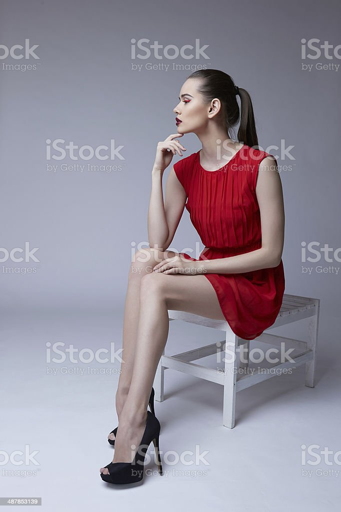 Red dress red hair nationality
