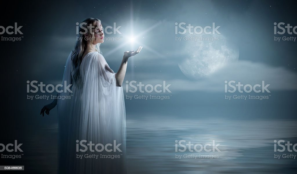 Young elven girl with star on sea coast stock photo