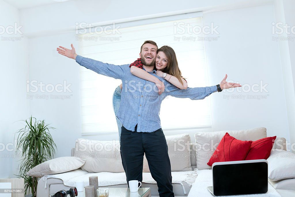 Young Embraced Couple Welcoming in their New Home stock photo