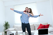 Young Embraced Couple Welcoming in their New Home