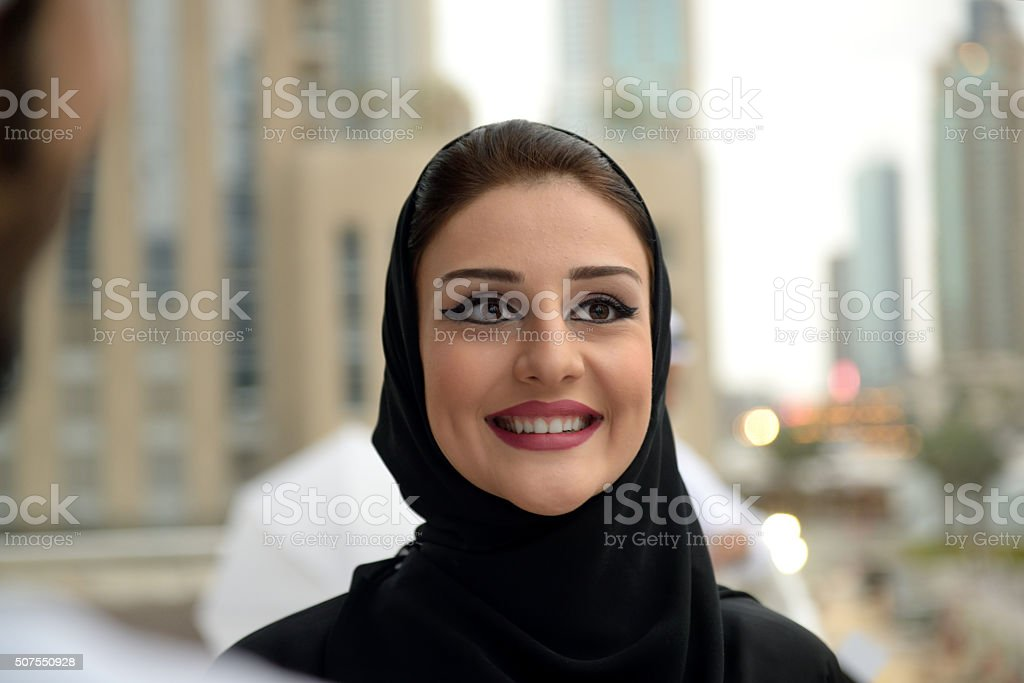 Young Emirati couple standing and talking stock photo
