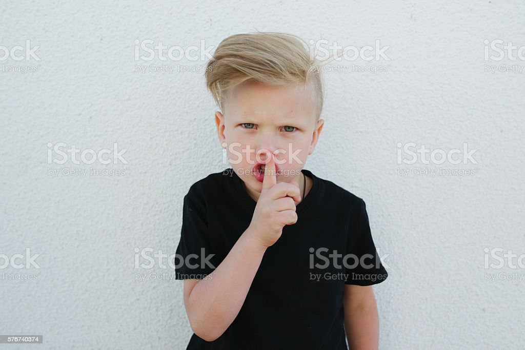 young emotional boy on bright background stock photo