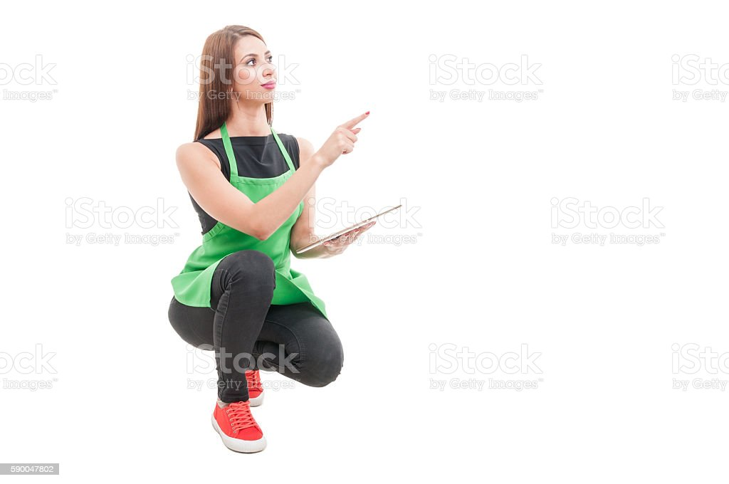 Young employee doing inventory and pointing finger stock photo
