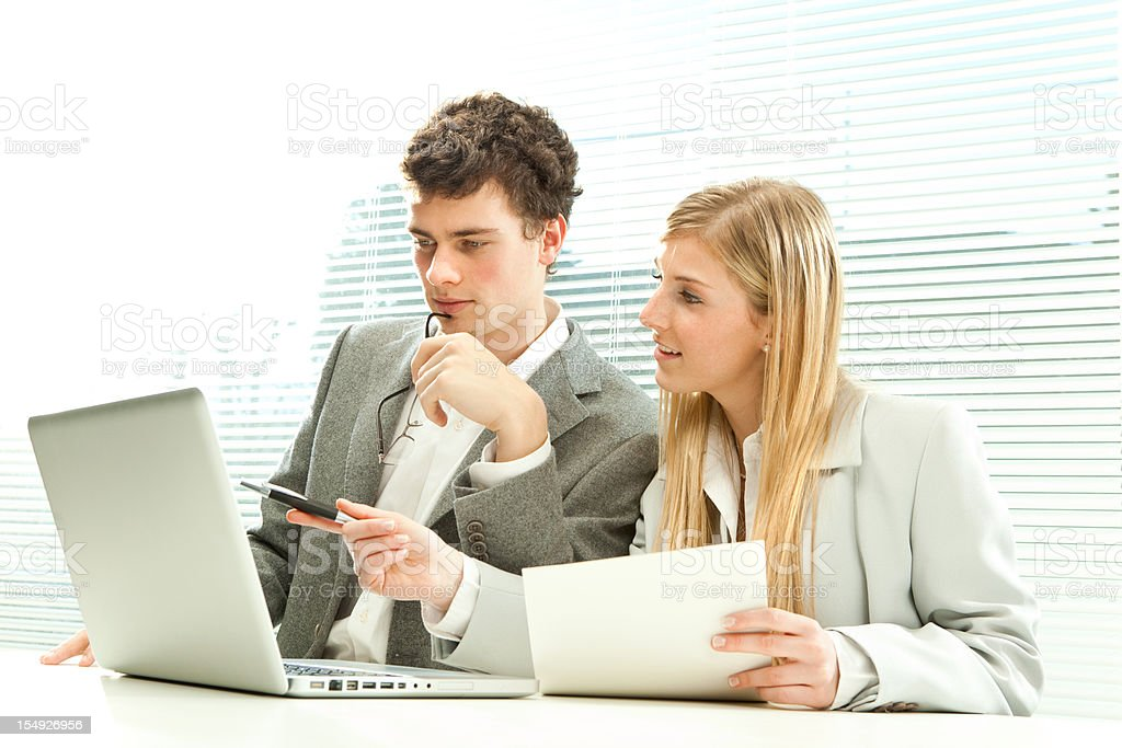 young employes or business people work at office with laptop stock photo