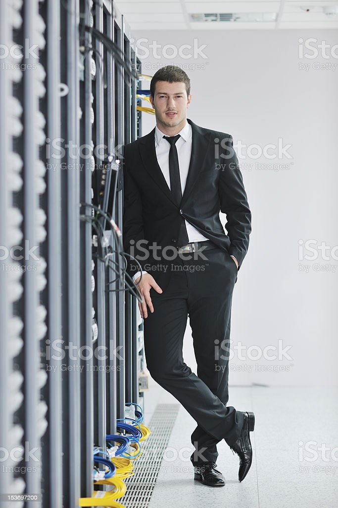 young engeneer in datacenter server room royalty-free stock photo