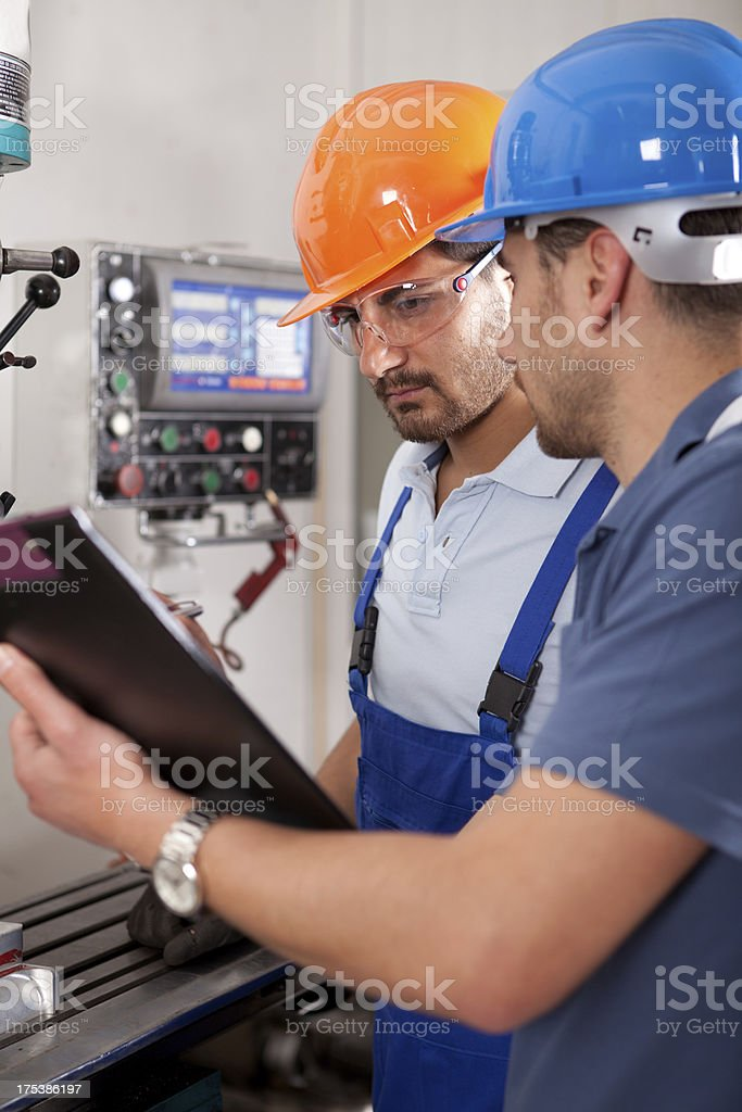 Young Engineer and Foreman royalty-free stock photo