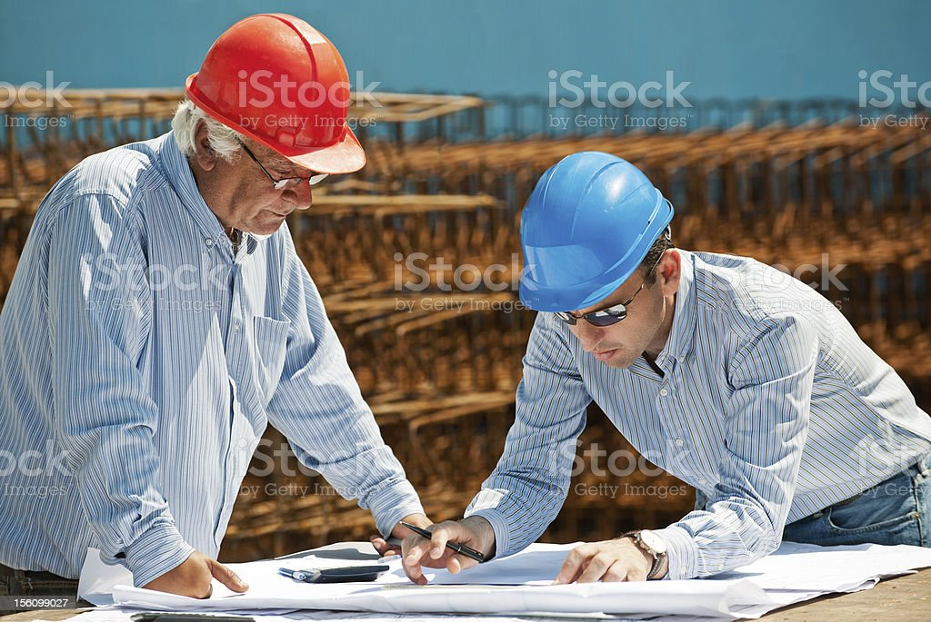 Young engineer and senior foreman stock photo