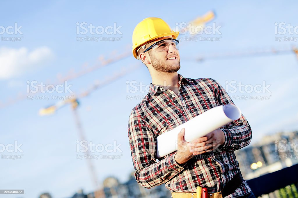 Young engineer at construction site stock photo