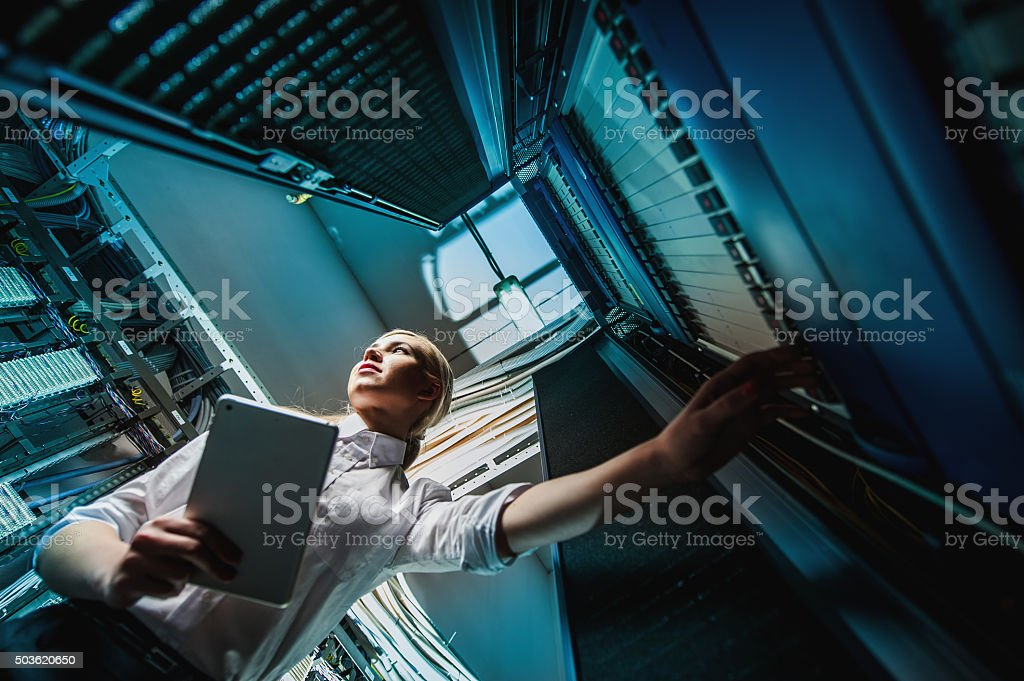 Young engineer businesswoman in server room stock photo