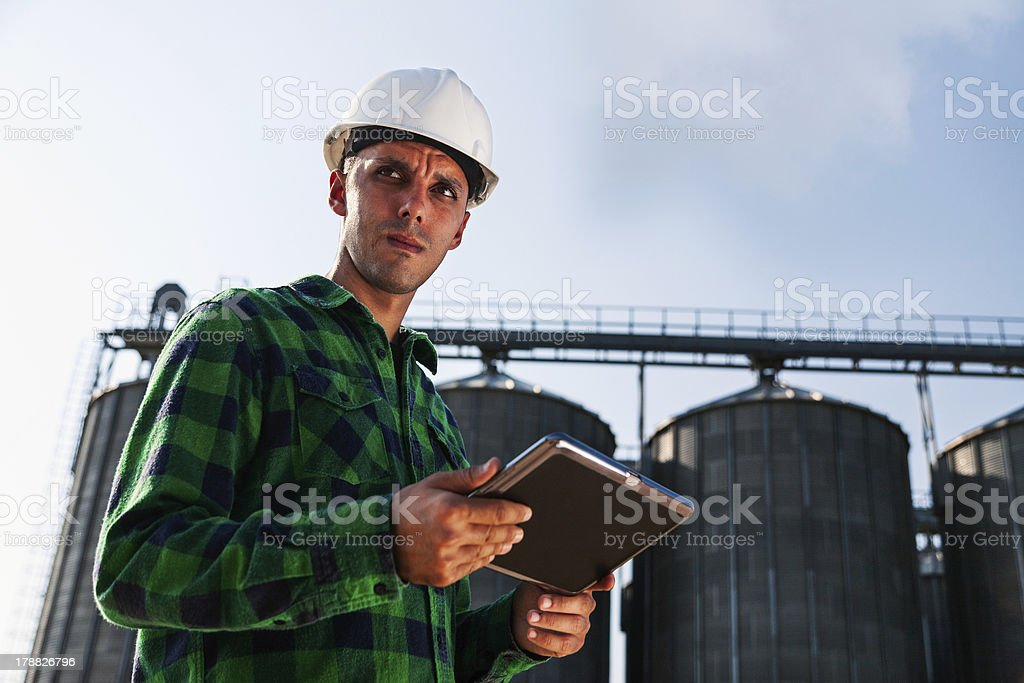 Young engineer holding a digital tablet royalty-free stock photo