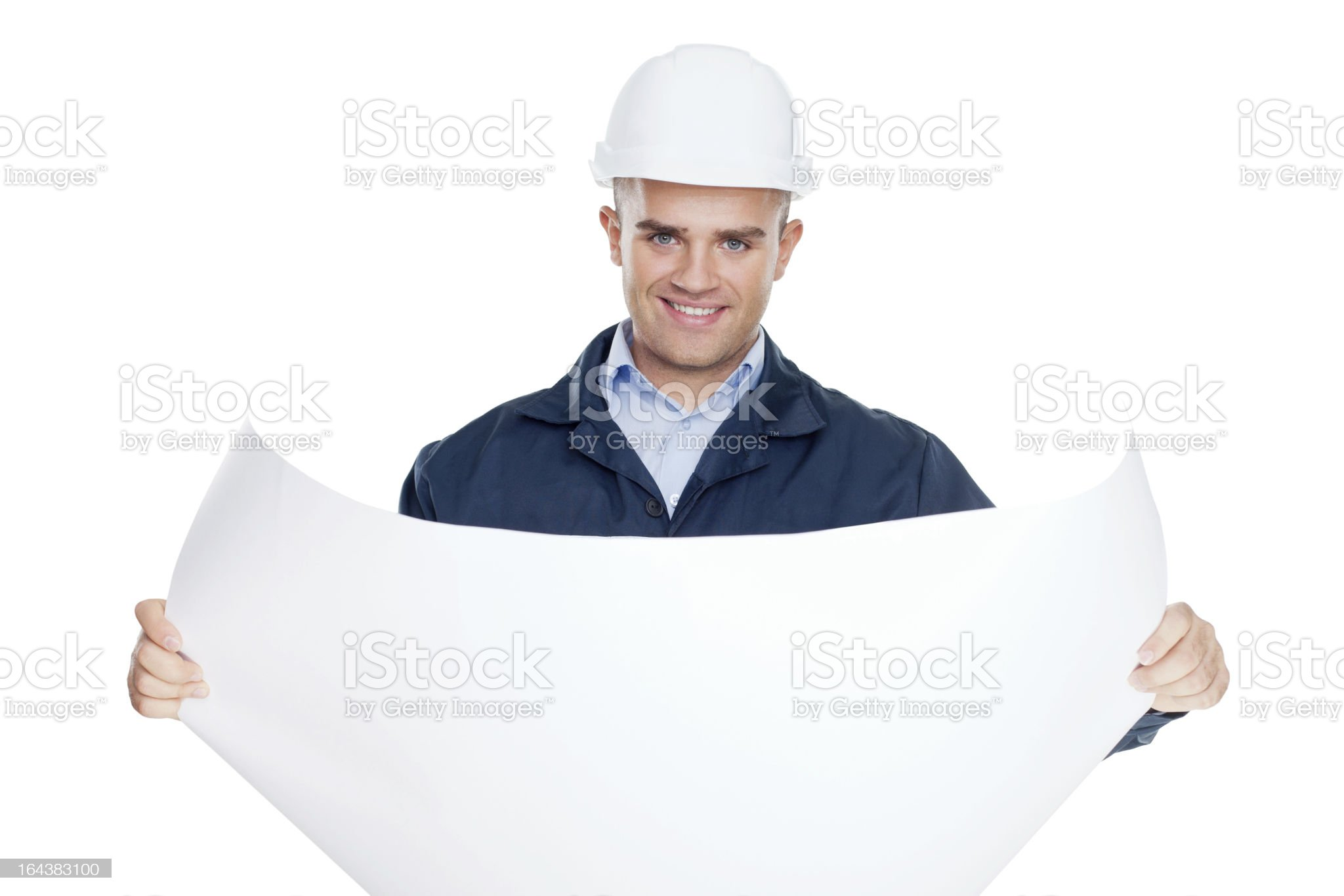 Young engineer looking at blueprint isolated on white royalty-free stock photo