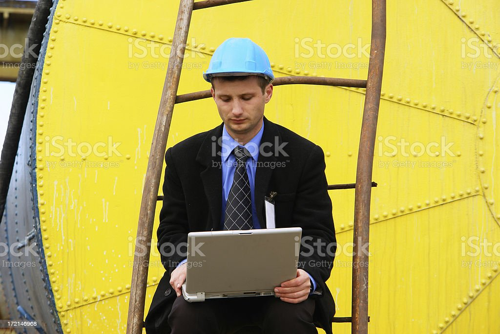 Young engineer making the last calculus royalty-free stock photo