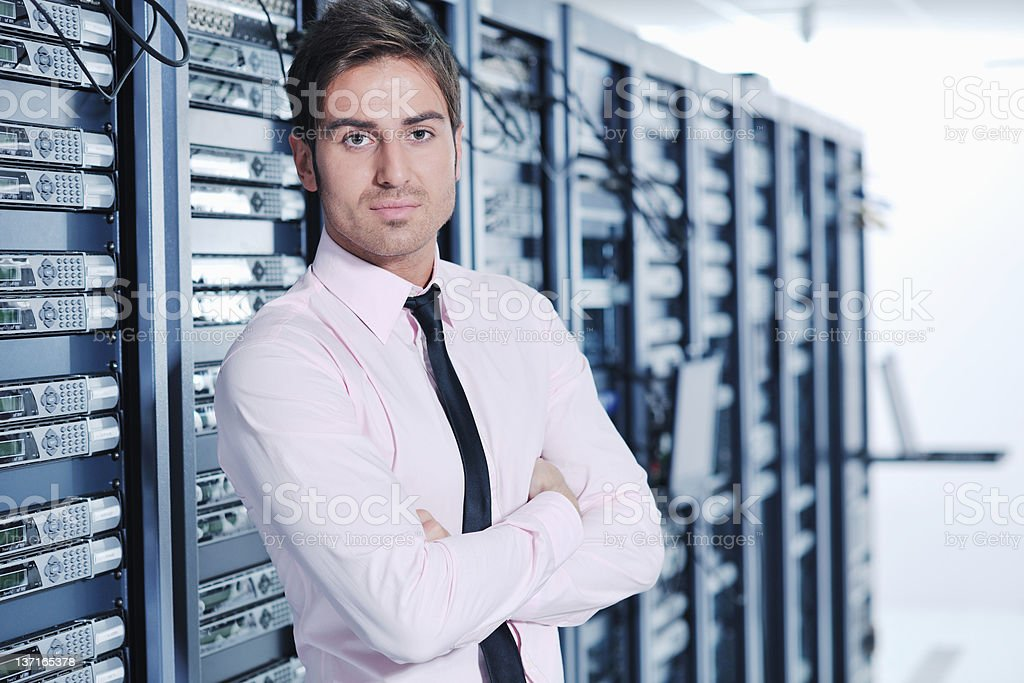 Young engineer posing in server room royalty-free stock photo
