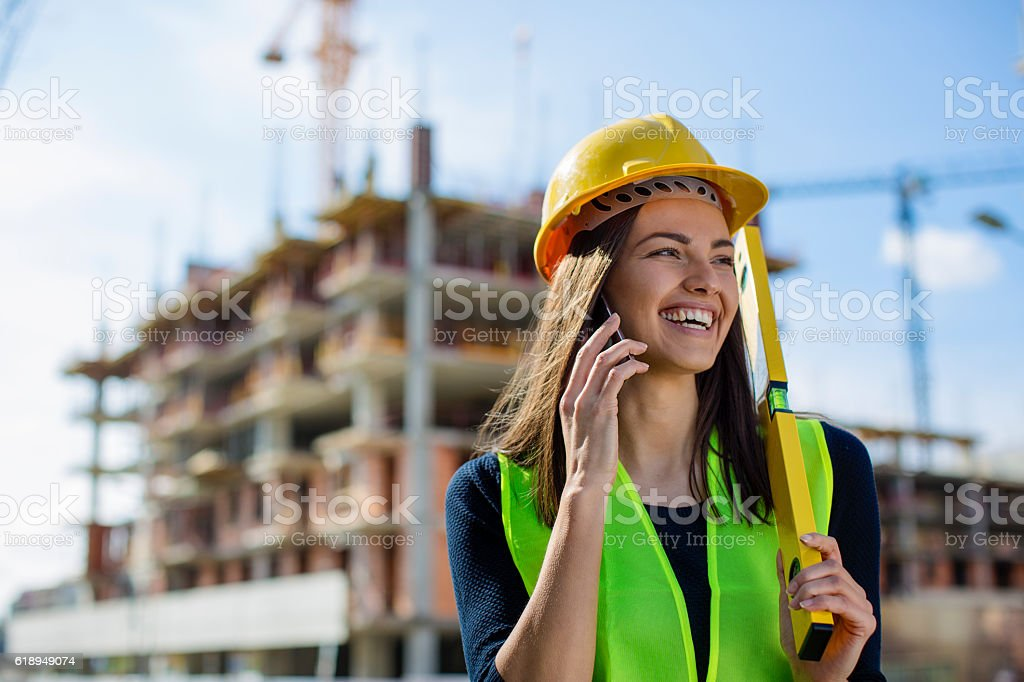 Young engineer talking on her phone stock photo