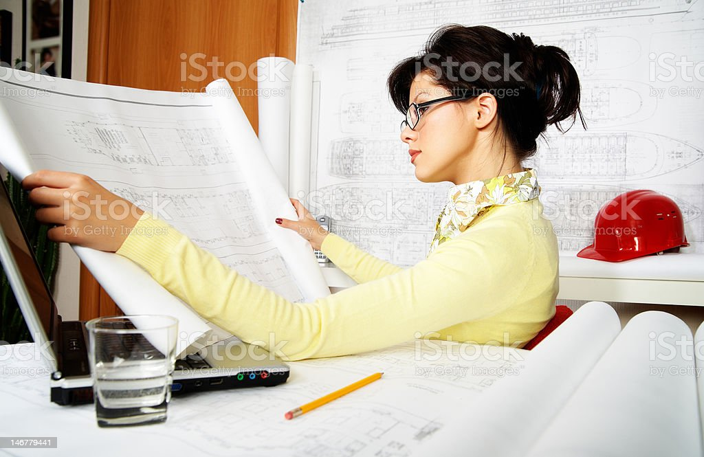 young engineer with blueprints royalty-free stock photo