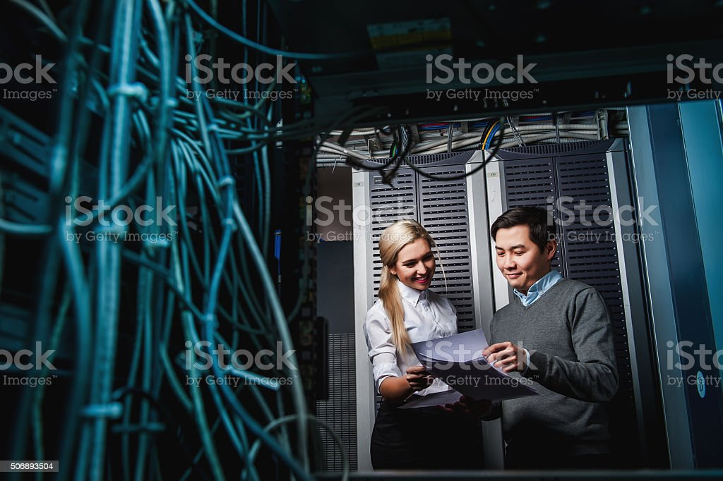 Young engineers businessmen in server room stock photo