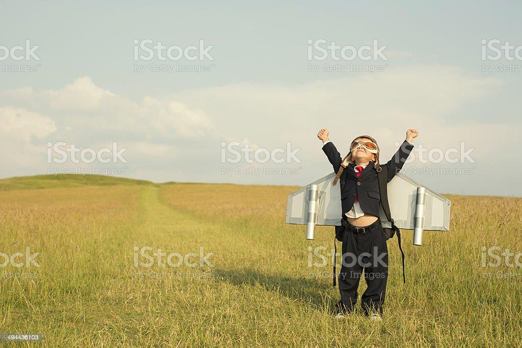 Young English Boy Businessman Wearing Jetpack stock photo