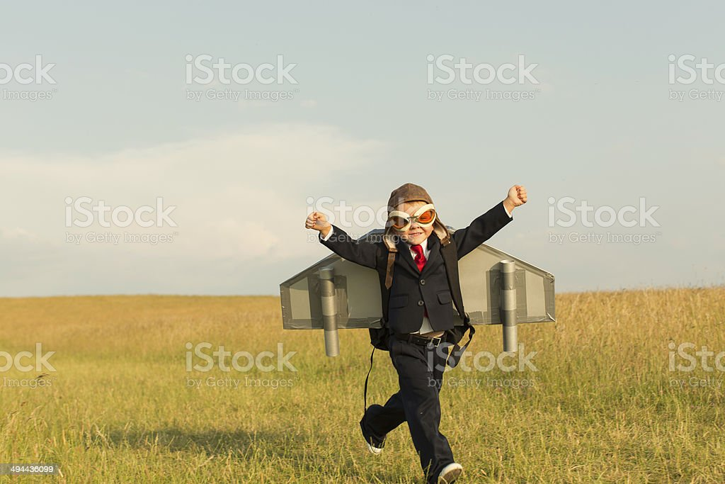 Young English Boy Dressed in Suit Wearing Jetpack stock photo