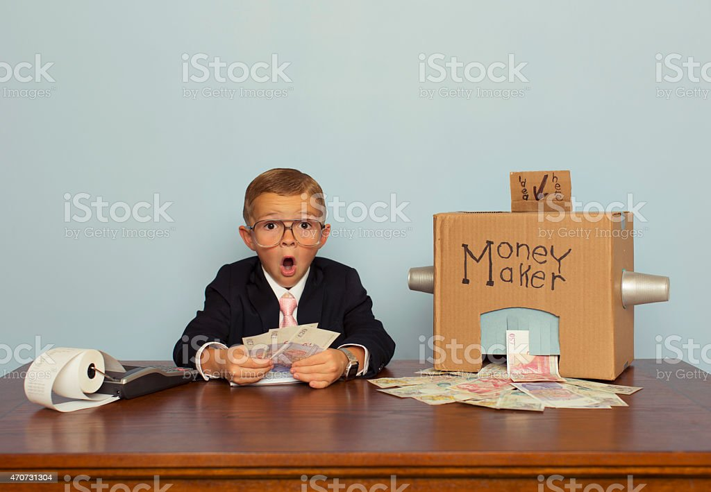 Young English Boy Makes Big Money stock photo