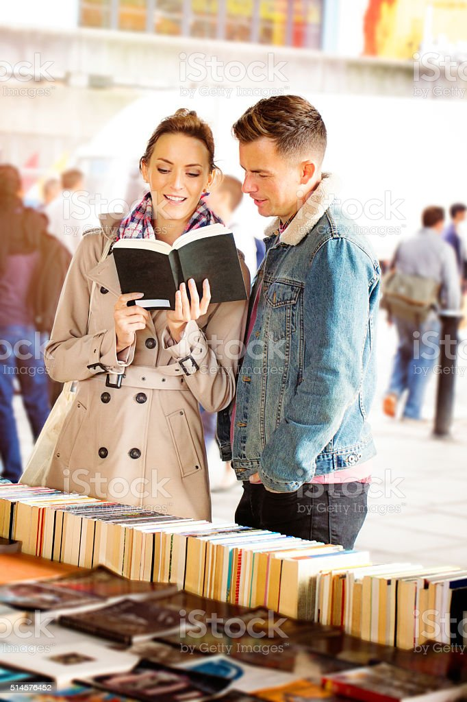 Young English couple looking at books on a date stock photo