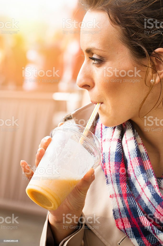 Young English woman drinking a healthy smoothie stock photo