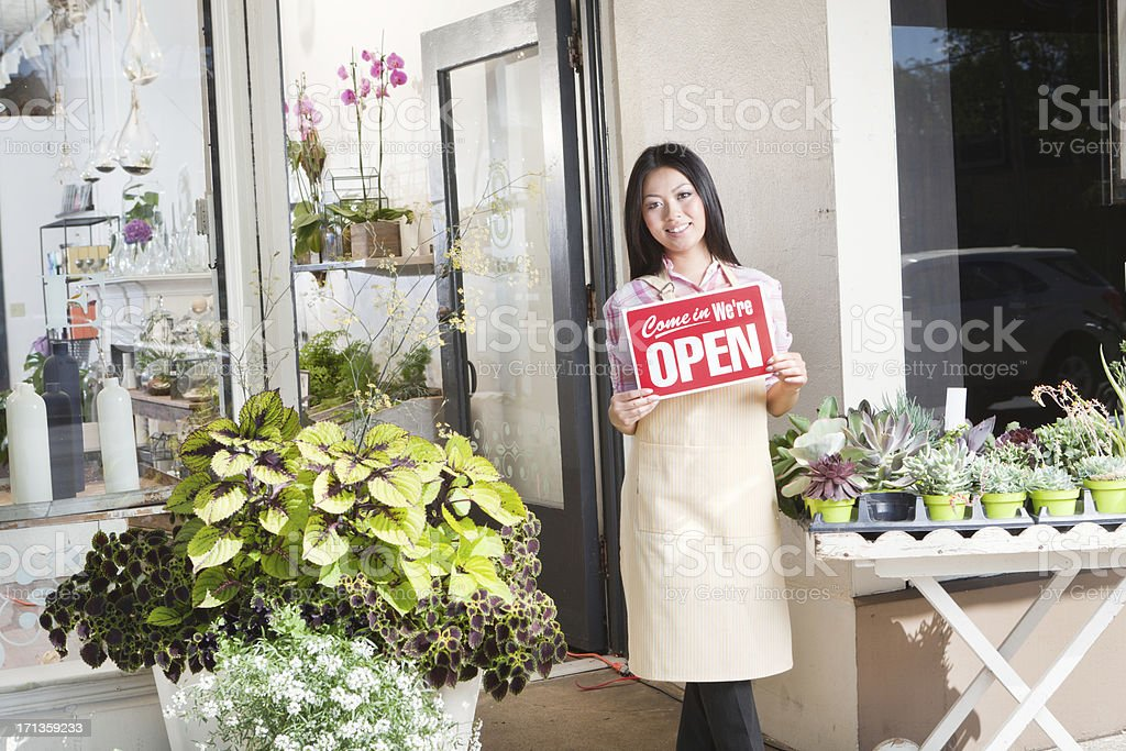 Young Entrepreneur Business Owner Holding up Store Open Sign Hz stock photo