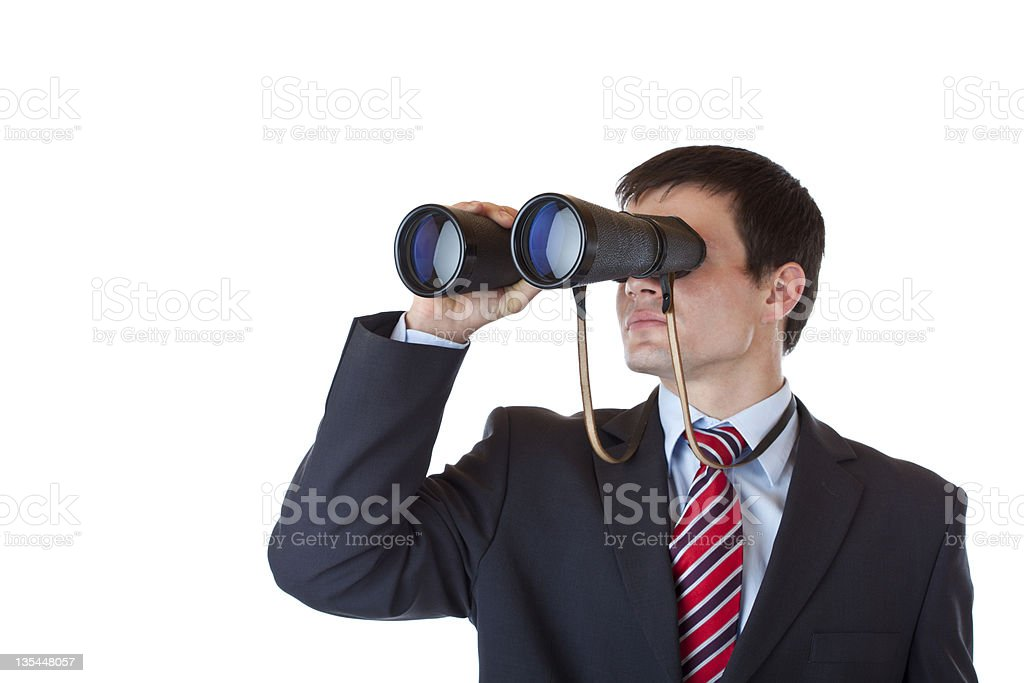 Young entrepreneur peers through binoculars and search for caree stock photo