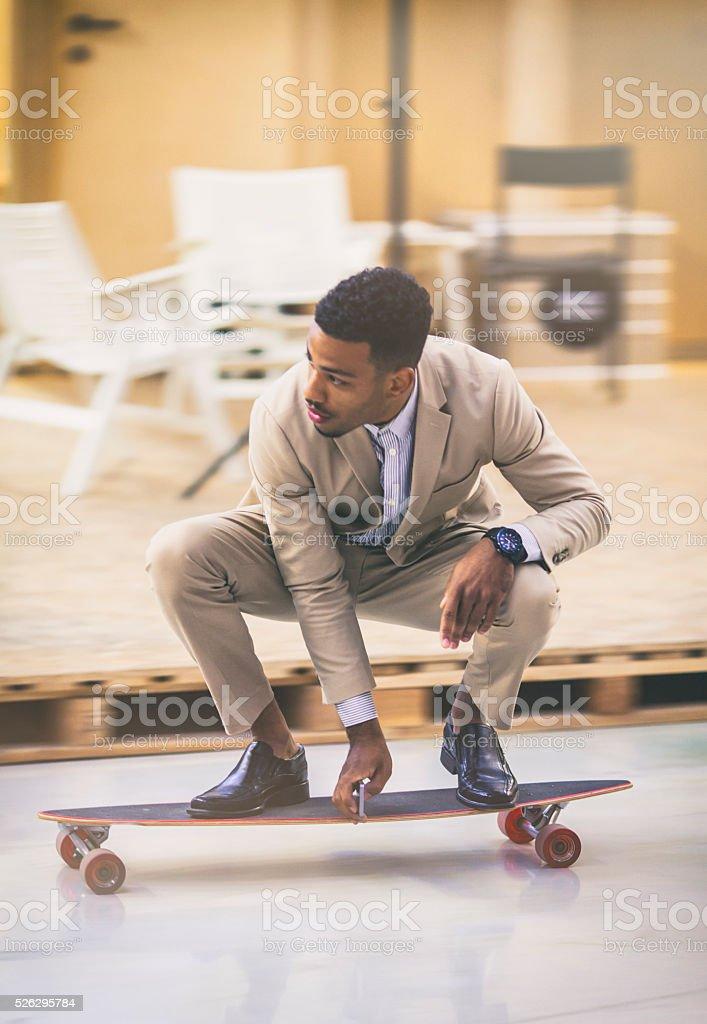 Young entrepreneur skateboarding stock photo