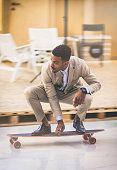 Young entrepreneur skateboarding