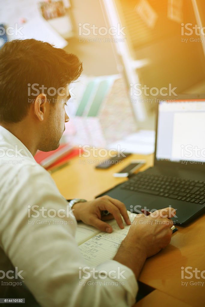 Young entrepreneur working from office. stock photo