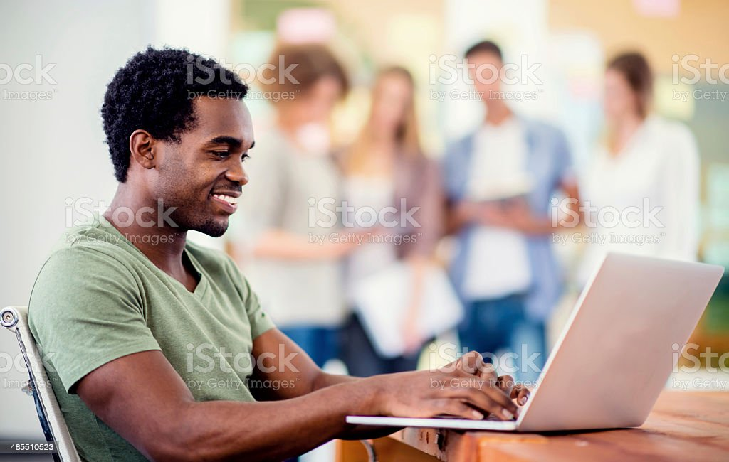 Young entrepreneur working online stock photo