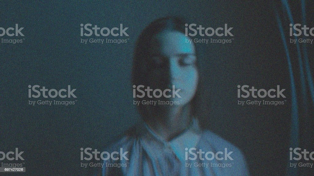 Young esoteric relaxing girl with colorful lights aura. Virtual reality fantasy art. stock photo