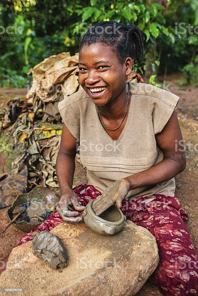 Young Ethiopian woman making pottery stock photo